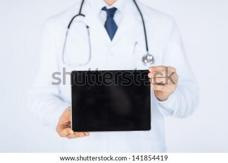 close up of male doctor holding tablet pc - stock photo