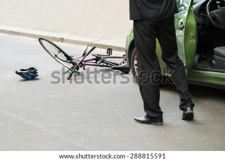 Close-up Of Male Driver After Collision With Bicycle On Road - stock photo