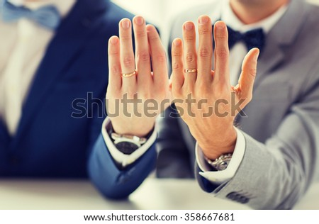close up of male gay couple with wedding rings on - Gay Wedding Ring
