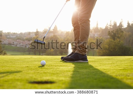 Close Up Of Male Golfer Putting On Green - stock photo