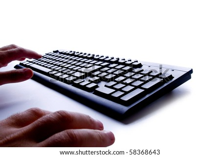 Close-up of male hand before touching button of black computer keyboard