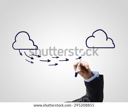 Close up of male hand drawing cloud computing concept