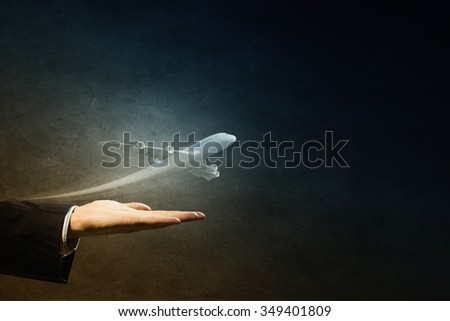 Close up of male hand holding airplane model - stock photo
