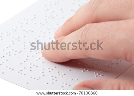 Close up of male hand reading braille text