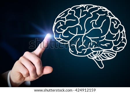 Close up of male hand touching brain on blue screen - stock photo