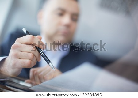 Close-up of male hand with pen - stock photo