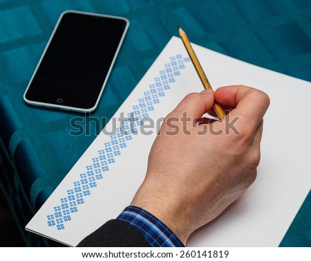 Close up of male hands doing paperwork with pencil - stock photo