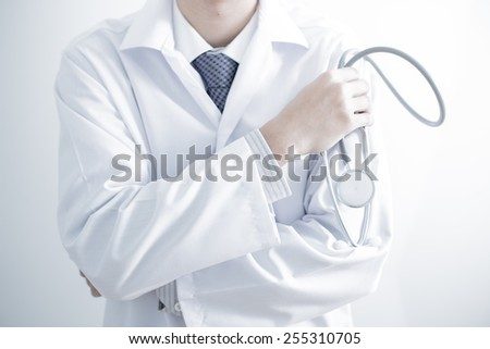 Close-up of male hands filling in medical form - stock photo
