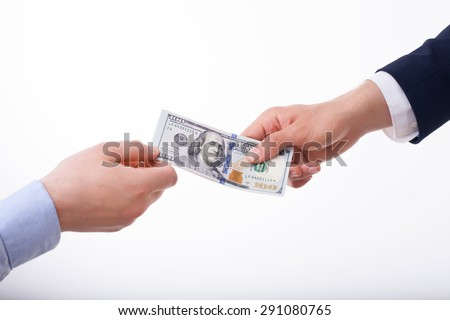 Close up of male hands giving money to another person. Isolated on white background