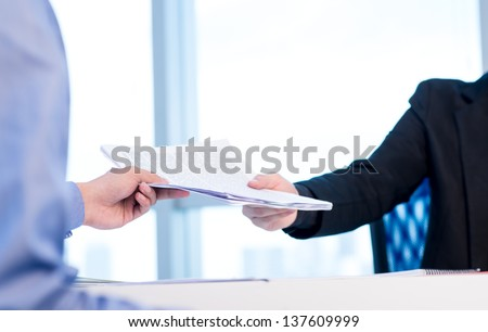 Close-up of male hands holding workpaper at office - stock photo