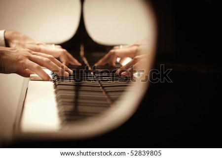 close up of male hands playing piano. Horizontal shape, copy space - stock photo