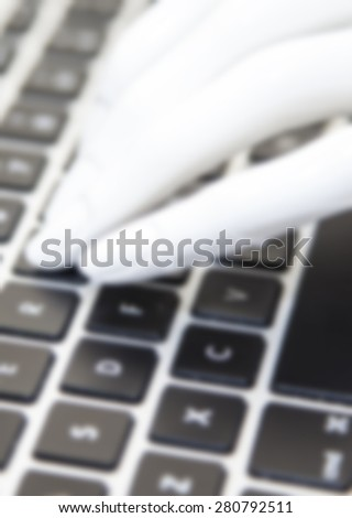 Close-up of male hands typing on laptop keyboard - stock photo