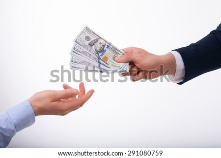 Close up of male hands with money. The man is giving dollars to another guy. Isolated on white background