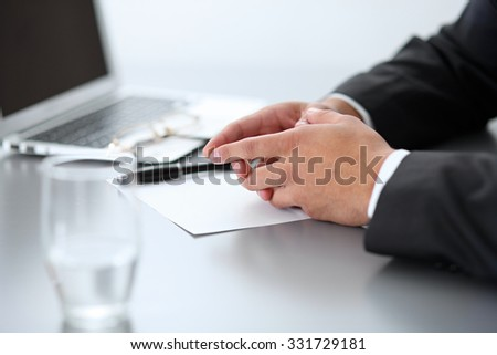 Close-up of male hands with pen over document,  business concept