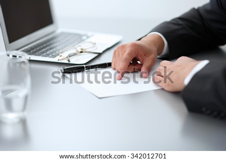 Close-up of male hands with pen over document,  business concept - stock photo