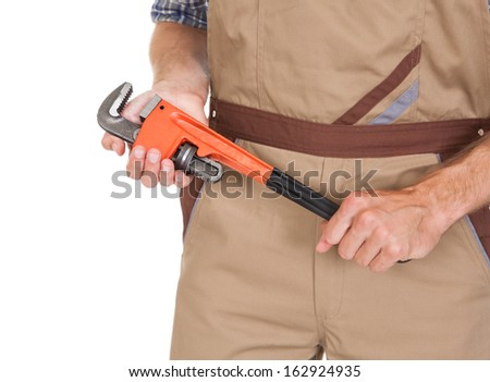Close-up Of Male Worker Holding Wrench Isolated On White Background - stock photo