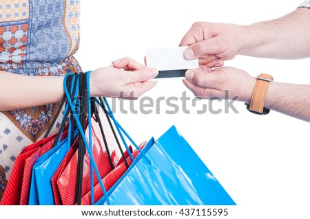 Close-up of man and woman hands fighting for credit card as no more overspending concept isolated on white background - stock photo