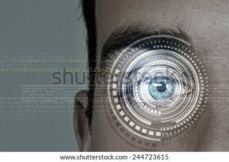 Close up of man eye in process of scanning - stock photo