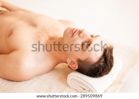 close up of man face in spa salon - stock photo