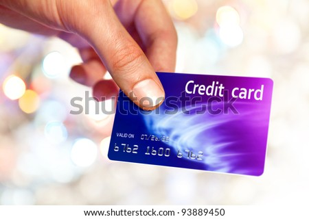 Close-up of man hand holding plastic credit card - stock photo