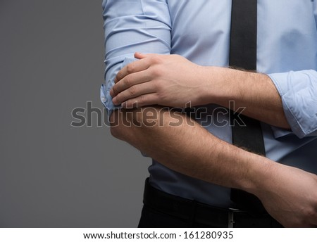 Close up of man hand throwing sleeve. Looking fashionable and classy - stock photo