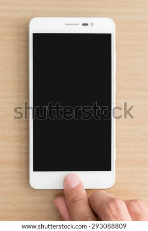 Close up of man hand touching on smart phone - stock photo