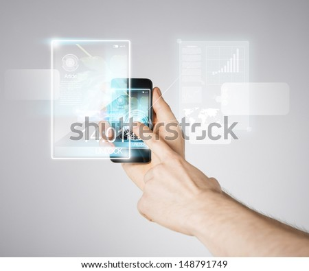 close up of man hand with smartphone and virtual screen - stock photo