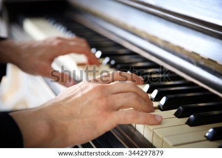 Close up of man hands classic piano playing - stock photo