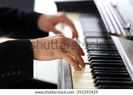 Close up of man hands piano playing - stock photo