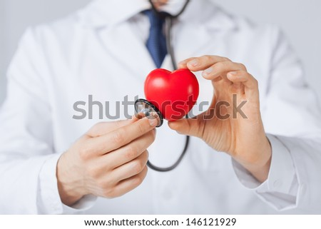 close up of man hands with heart - stock photo