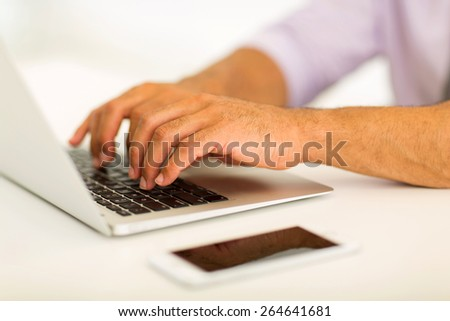close up of man hands working on laptop - stock photo