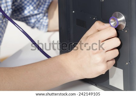 Close-up of man healing broken laptop - stock photo