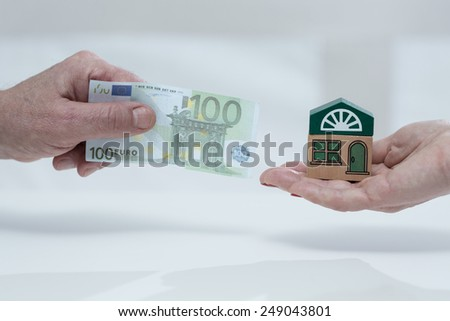 Close-up of man holding monthly house fee - stock photo