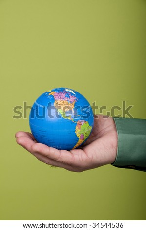 Close up of man holding small globe