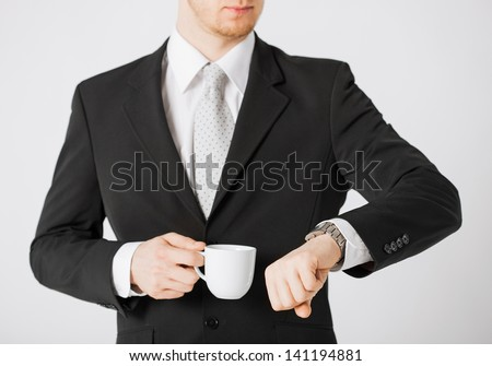 close up of man looking at wristwatch - stock photo