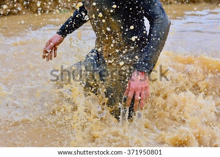 Close-up of man making splashes of dirty water.Unrecognizable - stock photo