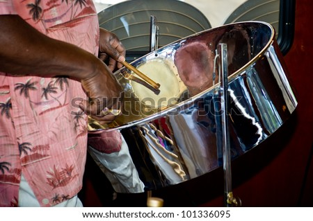 close up of man playing a steel drum - stock photo