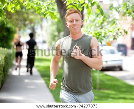 Close-up of man running against blur background - stock photo
