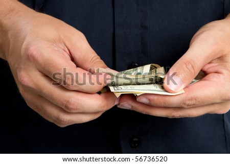 Close up of man's hand counting the money he made.