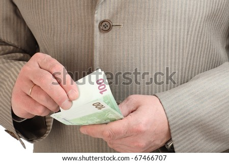 Close-up of man's hands counting euro banknotes