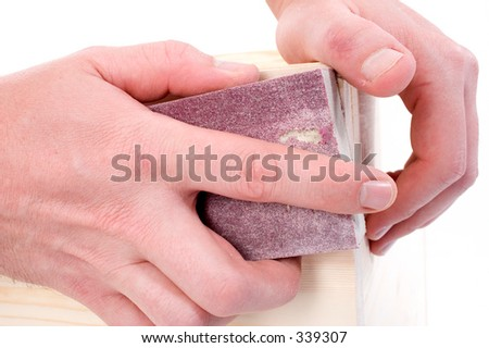Close Up Of Man's Hands Using Sanding Pad.