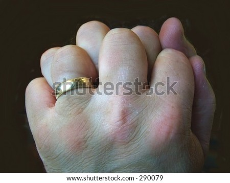 Close up of man's rough hands, wearing wedding ring - stock photo
