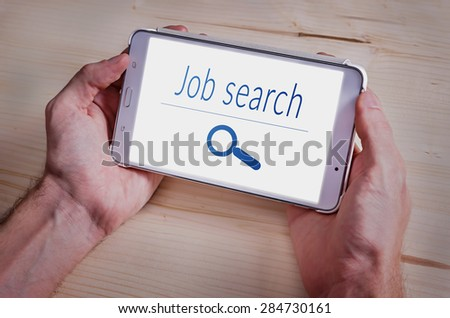 Close-up Of Man Search Job Online With Digital Tablet - stock photo