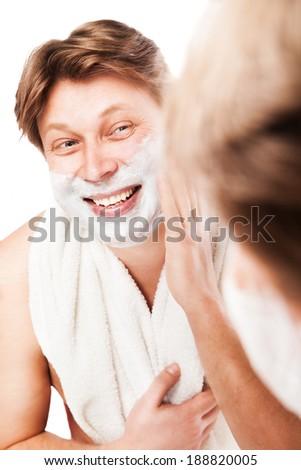 Close up of man shaving isolated over white background - stock photo