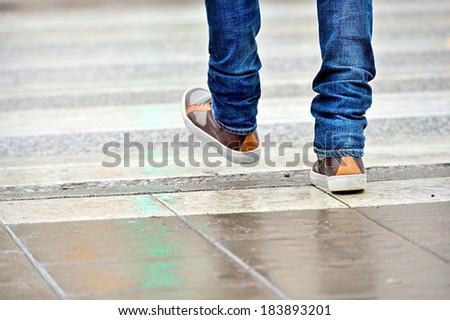 Close up of man shoes walking - stock photo