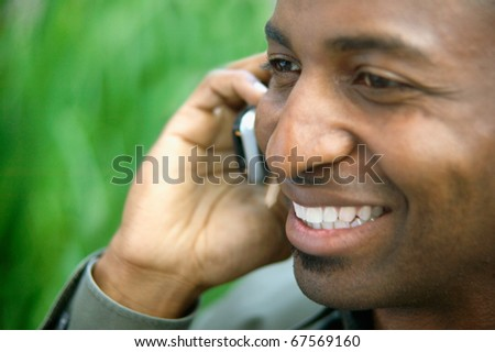 Close up of man talking on cell phone - stock photo