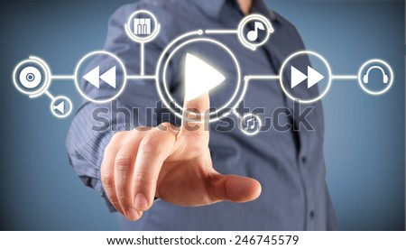 Close up of man touching application icon on screen - stock photo