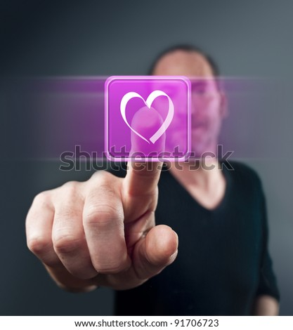 Close-up of man touching heart shape icon