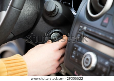 close up of man turning on his car. - stock photo