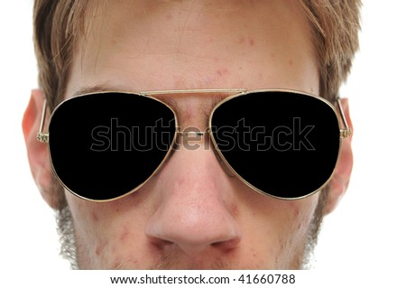 Close up of man with aviators sun glasses on white background - stock photo